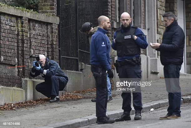 Members of the forensic team arrive at Colline street in Verviers eastern Belgium on January 16 after police shot dead two suspects in a gun battle...
