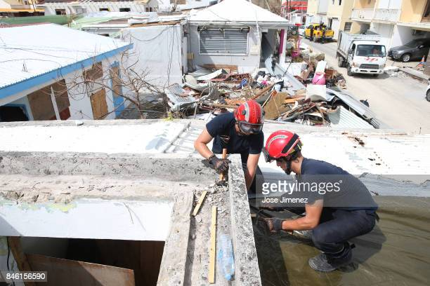 Members of the Formations Militaires Securite Civile fix a roof in Grande Case Saint Martin days after this Caribbean island sustained extensive...