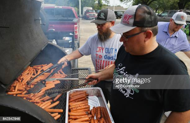 Members of the Franklin Church of Christ from Franklin Texas cook hotdogs for the congregation of the Fifth Ward Church of Christ in Houston on...