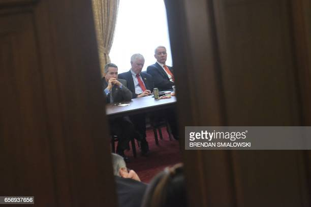 Members of the Freedom Caucus are seen in a meeting after coming back from the White House where they met with US President Donald Trump to discuss...