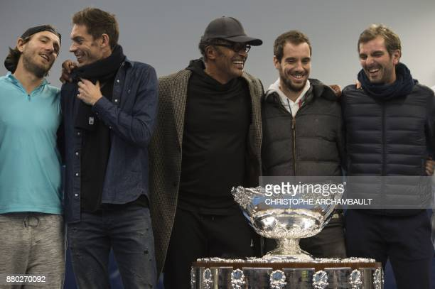 Members of the French Davis Cup team Lucas Pouille Nicolas Mahut captain Yannick Noah Richard Gasquet and Julien Benneteau pose with the trophy a day...