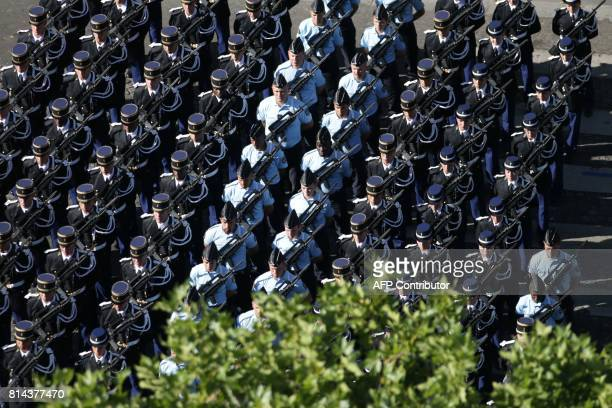 Members of the French gendarmerie gather before the start of the annual Bastille Day military parade on the ChampsElysees avenue in Paris on July 14...