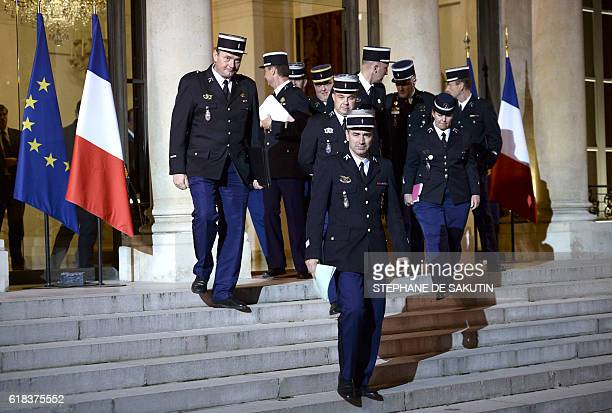 Members of the French Gendarmerie walk towards the waiting press following a meeting between the French Interior Minister French President and...