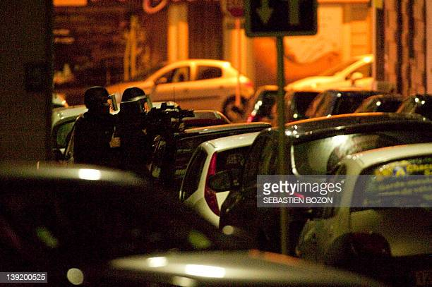 Members of the French GIPN unit stand in a street as a 41 year old man drunk and armed sequesters his 12 year old girl in his apartment in Mulhouse...