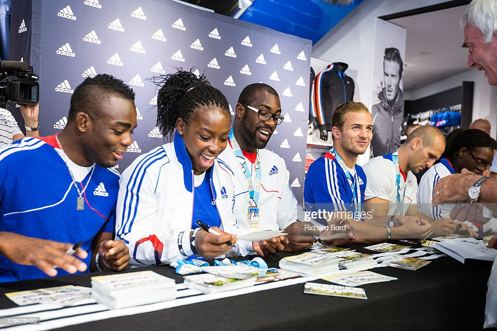 Members of the French National Judo Team, Dimitri Dragin, Gevrise Emane, Teddy Riner, Ugo Legrand, Alain Schmitt and Emilie Andeol attend a signing session at Adidas Performance Store Champs-Elysees on September 4, 2013 in Paris, France.