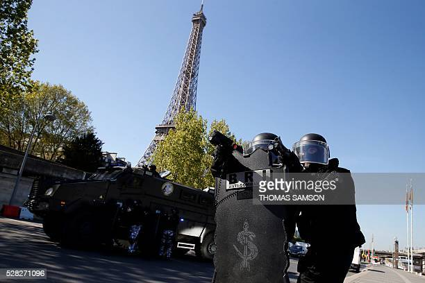 Members of the French national police elite research intervention group take part in an exhibition with the group's new armored truck named 'Titus'...