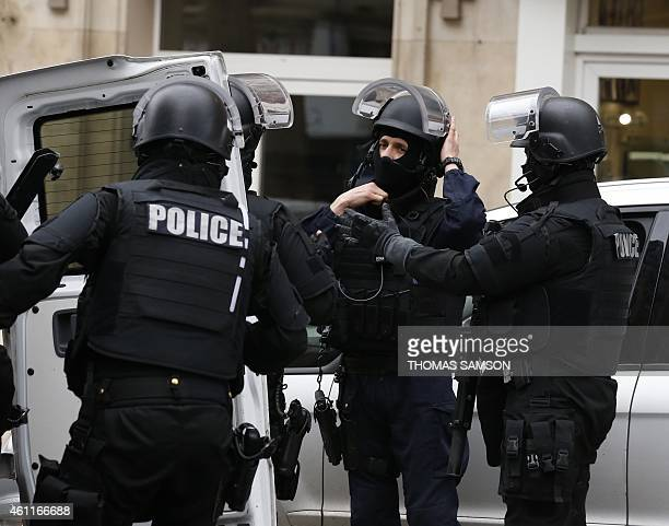 Members of the French national police intervention group arrive at the scene where a female police officer was shot dead in Montrouge a southern...