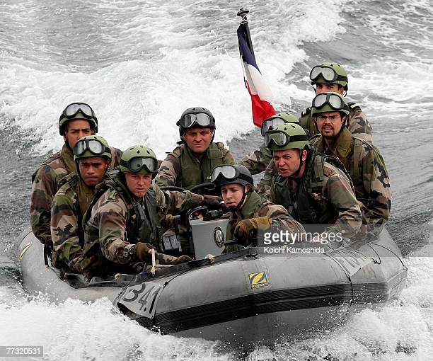 Members of the French Navy approach a suspicious ship during the Proliferation Security Initiative Maritime Interdiction Exercise 'Pacific Shield 07'...