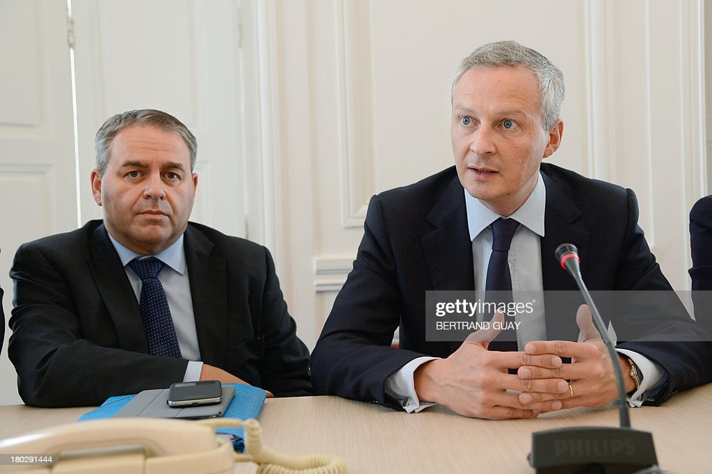 Members of the French parliament, former French minister Xavier Bertrand (L) and former Agriculture minister Bruno Le Maire (R) attend a press conference at the National Assembly in Paris on September 11, 2013. The opposition parliamentarians announced today that they would propose a new law which would abolish taxes on overtime work, a measure which had previously been implemented by right-wing former French President Nicolas Sarkozy and was changed after the new left-wing government of French President Francois Hollande came to power.
