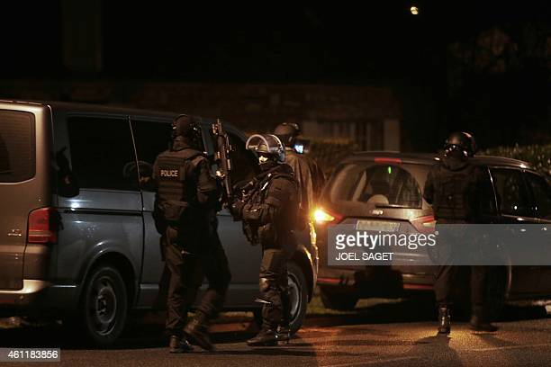 Members of the French police intervention force carry out searches in Fleury northern France on January 8 2015 as part of an investigation into a...