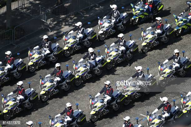 Members of the French police march during the annual Bastille Day military parade on the ChampsElysees avenue in Paris on July 14 2017 The parade on...