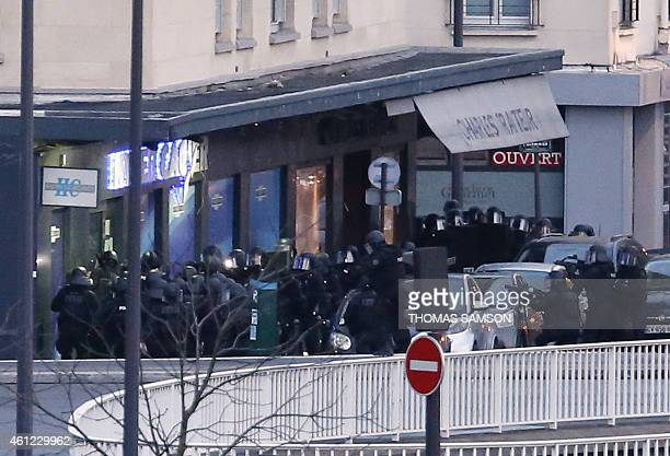 Members of the French police special forces launch the assault at a kosher grocery store in Porte de Vincennes eastern Paris on January 9 2015 where...