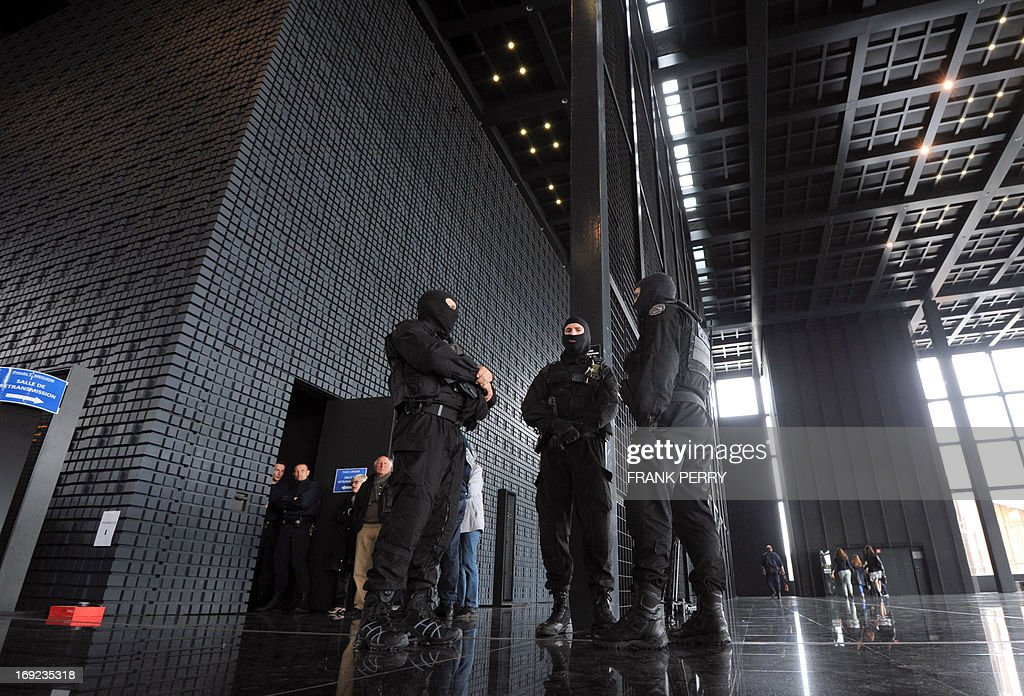 Members of the French police special forces (GIPN) secure the criminal court of Nantes before the trial of Tony Meilhon at the courthouse in Nantes, western France, on May 22, 2013. Tony Meilhon, suspected of the killing of teenager Laetitia Perrais in January 2011, is on trial from May 22 to June 7.
