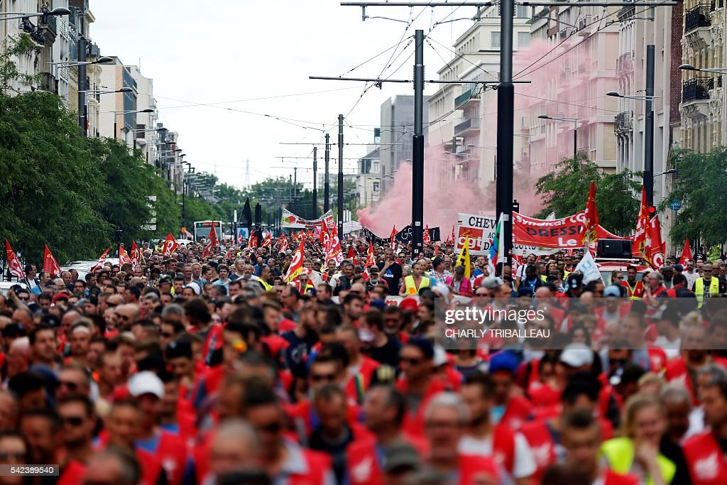 TOPSHOT Members of the French worker's union gather for a march on June 23 in Le Havre to protest against a series of controversial labour reforms...