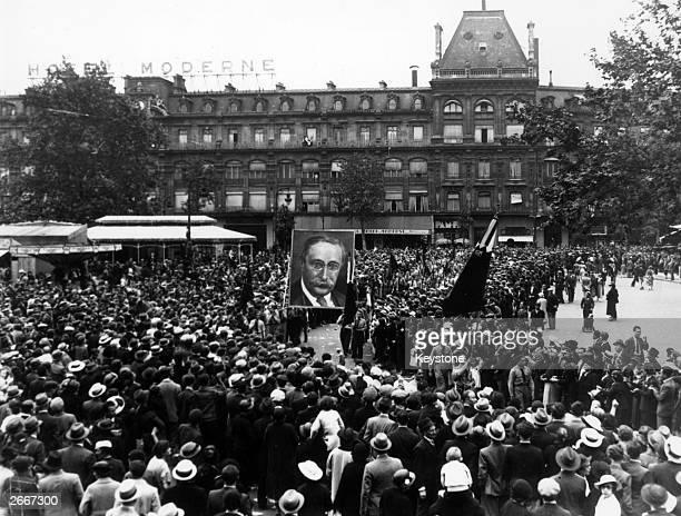 Members of the Front Populaire carrying a huge portrait of Socialist leader Leon Blum during a protest march in the Place de la Republique Paris
