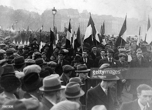 Members of the Front Populaire taking part in a huge proletarian demonstration in protest against the vicious Royalist attack on Socialist leader...