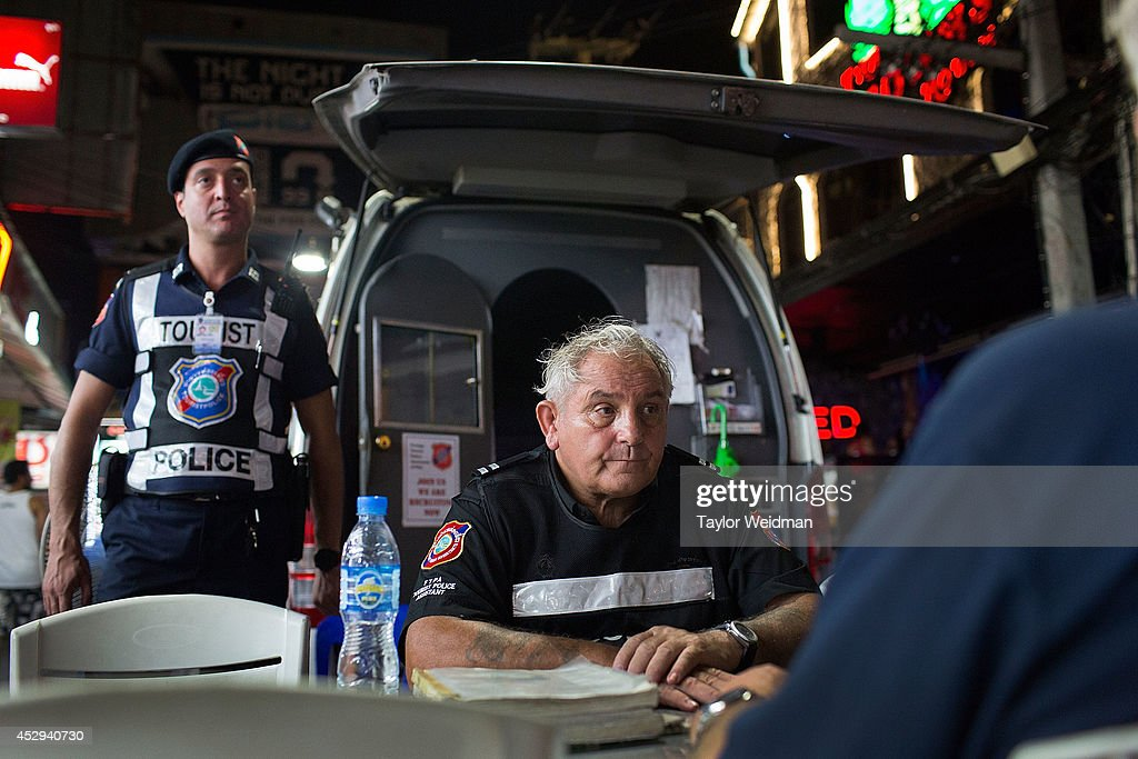 Members of the FTPA man the mobile headquarters of the tourist police on Pattaya's Walking Street on July 31, 2014 in Pattaya, Thailand. Since 2002, members of the Foreign Tourist Police Assistants (FTPA) of Pattaya have been assisting local police on Walking Street, Pattaya's main nightlife area. Members of the FTPA carry handcuffs, batons, and pepper spray, and are charged primarily with assisting foreign visitors and the Thai police, as well as breaking up fights and catching thieves.