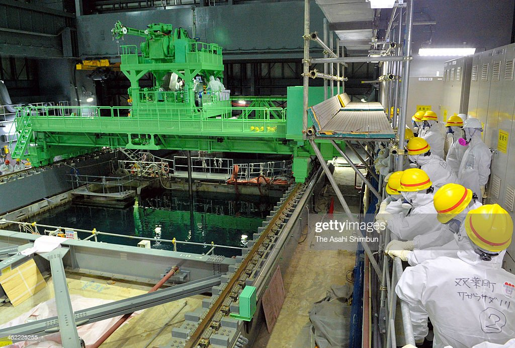 Members of the Fukushima Prefecture panel inspect the fuel rod removal opeation at the No.4 reactor of the Tokyo Electric Power Co (TEPCO) Fukushima Daiichi Nuclear Power Plant on November 26, 2013 in Okuma, Fukushima, Japan. TEPCO started the operation on November 18, expecting to remove all the 1,533 rods by December 2014.