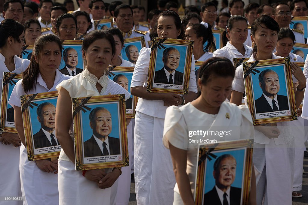 Members of the funeral procession carry portraits of former King Norodom Sihanouk on February 1, 2013 in Phnom Penh, Cambodia. Over half a million mourners lined the streets to pay their respects during the funeral procession which finished at the crematorium where his funeral pyre will be lit by his wife and son on the 4th of February. King Norodom Sihanouk died of a heart attack last October in Beijing at the age of 89. For the past three months his body has been lying in state at the Royal Palace.