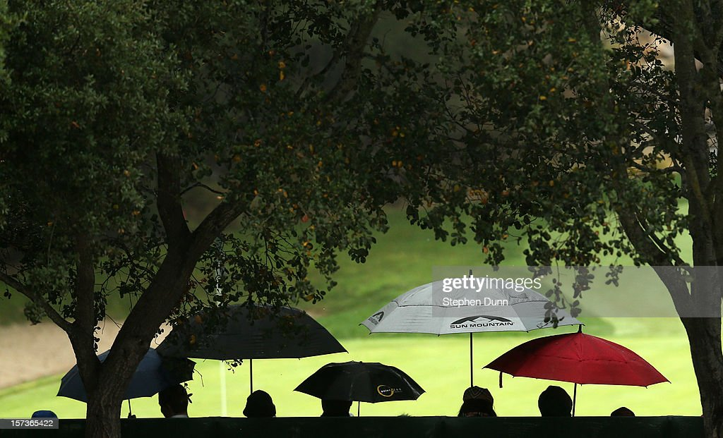 Members of the gallery hold umbrellas in the stands around the ninth green during the final round of the Tiger Woods World Challenge Presented by Northwestern Mutual at Sherwood Country Club on December 2, 2012 in Thousand Oaks, California.