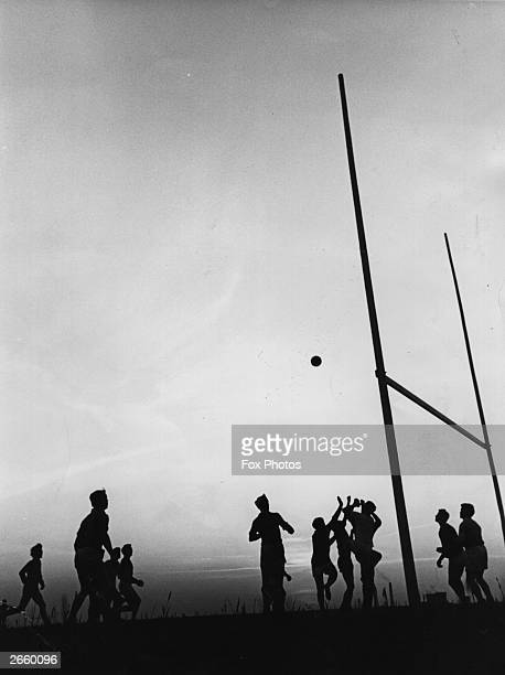 Members of the 'Gary Owen' Gaelic Football Club during a practice match at the GLC playing field at Wormwood Scrubs London