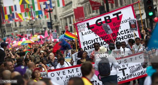 Members of the Gay and Lesbian community parade through London to celebrate the World Pride Festival on July 7 2012 AFP PHOTO/ANDREW COWIE