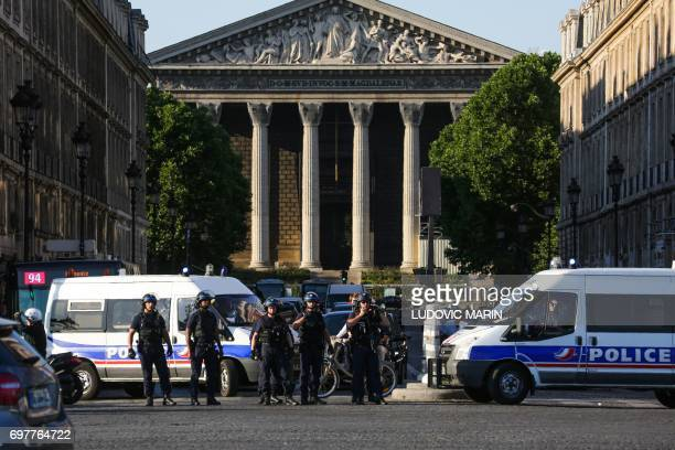Members of the Gendarmerie Mobile block the access to the rue Royale from the Concorde plaza as protesters end a demonstration called by the...