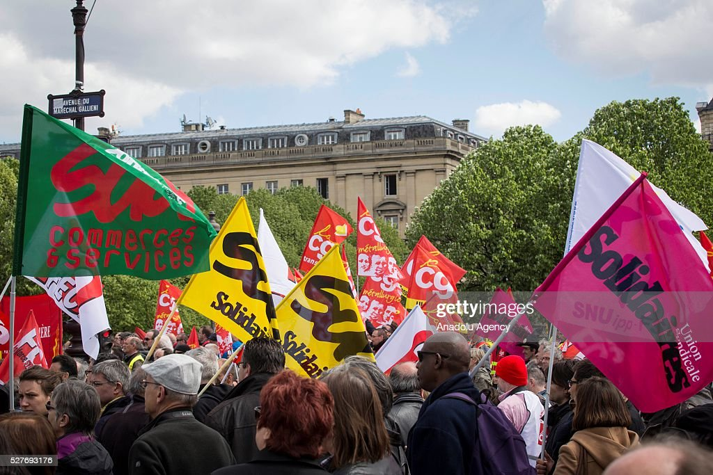 Members of the General Confederation of Labour (CGT), General Confederation of Labor - Workers' Force (FO) and French Confederation of Management General Confederation of Executives (CFE-CGC) gather in front of Invalides in Paris, France on May 03, 2016 during a protest against the planned labor law reforms also known as the 'El Khomri law' which has recently proposed by Labor Minister Myriam El Khomri.