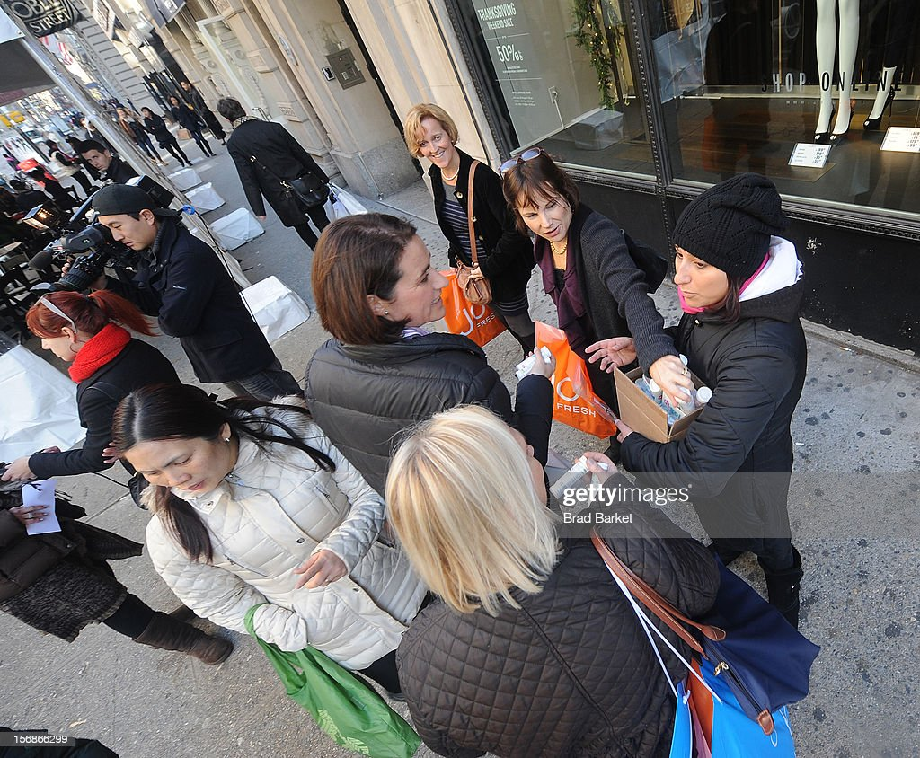 Members of the general public take free samples of di-gel as di-gel helps New Yorkers 'Undo' Black Friday Shopping Troubles>> on November 23, 2012 in New York City.