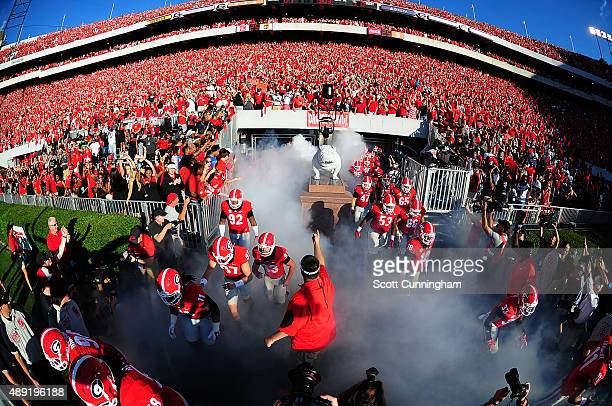 Members of the Georgia Bulldogs take the field before the game against South Carolina Gamecocks on September 19 2015 in Atlanta Georgia Photo by...