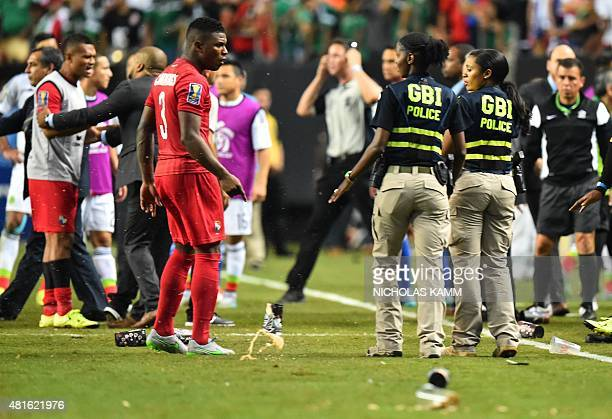 Members of the Georgia Bureau of Investigations police intervene as scuffles break out between members of Panama's and Mexico's national teams after...