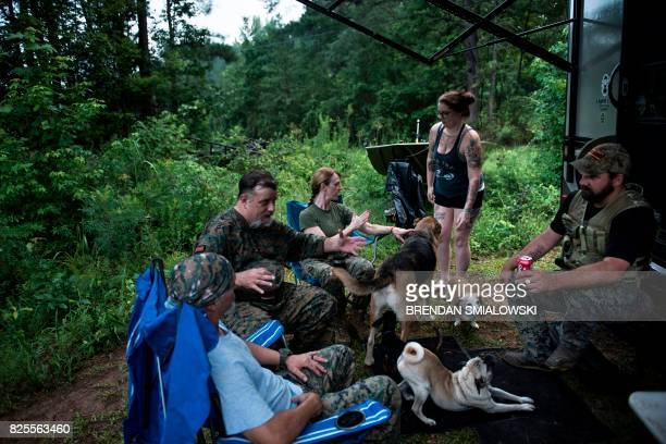 Members of the Georgia Security Force III% militia and others socialize during the morning hours during a field training exercise July 29 2017 in...