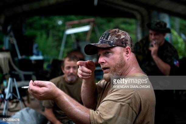 Members of the Georgia Security Force III% militia listen to founder Chris Hill give a briefing during a field training exercise July 29 2017 in...