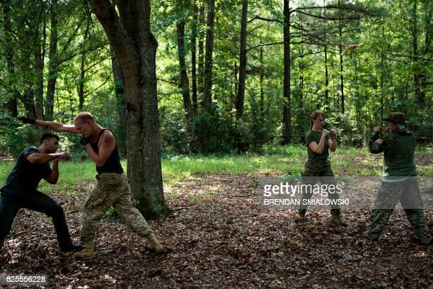 Members of the Georgia Security Force III% militia practice hand to hand combat during a field training exercise July 29 2017 in Jackson Georgia /...