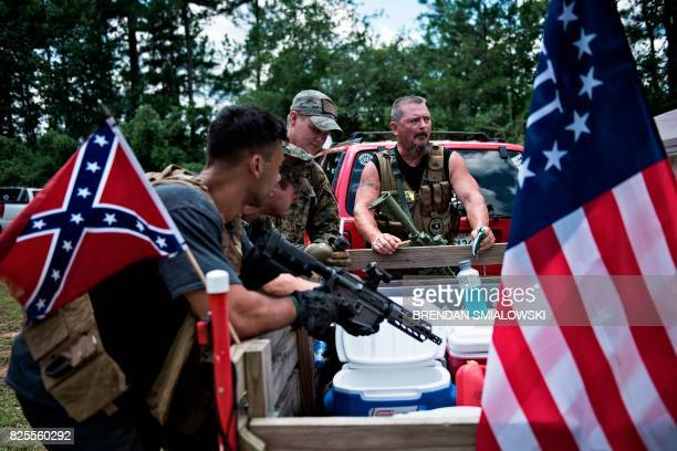 Members of the Georgia Security Force III% militia wait together during a field training exercise July 29 2017 in Jackson Georgia Each month Chris...