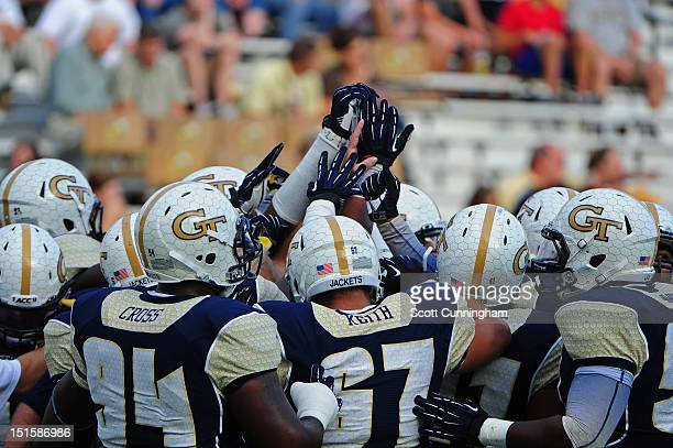 Members of the Georgia Tech Yellow Jackets huddle before the game against the Presbyterian Blue Hose at Bobby Dodd Stadium on September 8 2012 in...