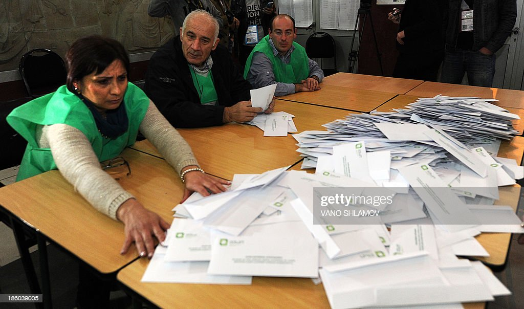 Members of the Georgian election committee count ballots after voting closed at a polling station during the presidential election in Tbilisi on October 27, 2013. An ally of billionaire Georgian Prime Minister Bidzina Ivanishvili claimed a crushing first-round victory in a presidential vote Sunday after his main opponent conceded defeat and exit polls pointed to an overwhelming win. Giorgi Margvelashvili, a little-known academic from the premier's Georgian Dream coalition, had at least 66 percent of the vote in two television exit polls, well ahead of former parliament speaker David Bakradze of outgoing President Mikheil Saakashvili's United National Movement party, in second place with around 20 percent in the ex-Soviet state.