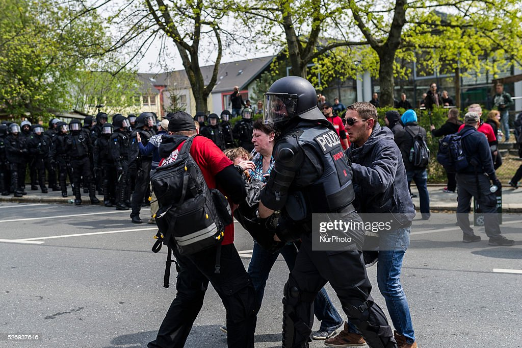 Members of the Gererman police take action against participants of a right-wing extremist rally in Plauen, Germany, 01 May 2016.