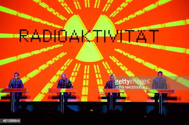 Members of the German band Kraftwerk perform their piece 'Radioactivity' during a concert at the Neue Nationalgalerie museum in Berlin on January 6...