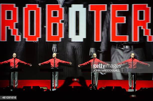 Members of the German band Kraftwerk perform their piece 'Roboter' during a concert at the Neue Nationalgalerie museum in Berlin on January 6 2015...