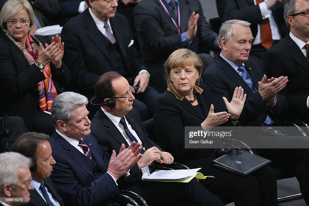 Members of the German Bundestag and French Assemble Nationale, including German Chancellor Angela Merkel and French President Francois Hollande (C), as well as German President <a gi-track='captionPersonalityLinkClicked' href=/galleries/search?phrase=Joachim+Gauck&family=editorial&specificpeople=2077888 ng-click='$event.stopPropagation()'>Joachim Gauck</a> (L) and French Prime Minister Jean-marc Ayrault, attend a joint session of the two governments at the Bundestag during the 50th anniversary celebration of the Elysee Treaty on January 22, 2013 in Berlin, Germany. The treaty, concluded in 1963 by Charles de Gaulle and Konrad Adenauer in the Elysee Palace in Paris, set a new tone of reconciliation between France and Germany, and called for consultations between the two countries to come to a common stance on policies affecting the most important partners in Europe as well as the rest of the region. Since its establishment, the document for improved bilateral relations has been seen by many as the driving force behind European integration.