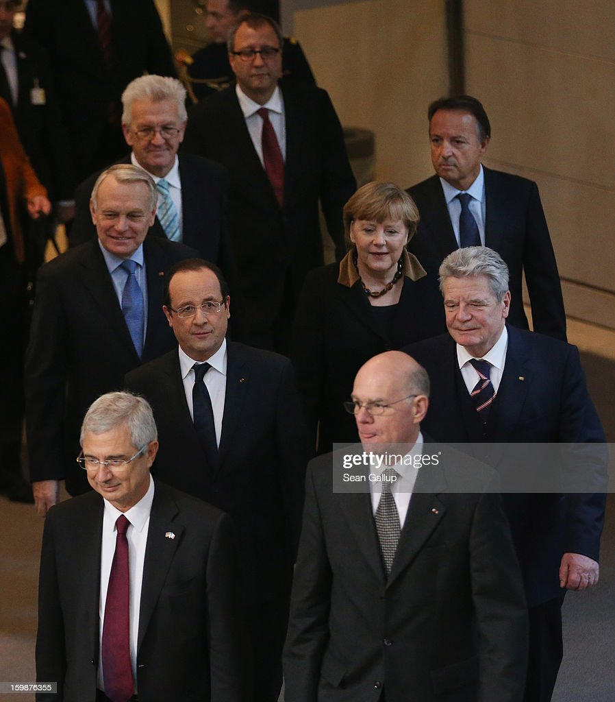 Members of the German Bundestag and French Assemblee Nationale, including German Chancellor Angela Merkel, French President Francois Hollande (2nd up from L), German President <a gi-track='captionPersonalityLinkClicked' href=/galleries/search?phrase=Joachim+Gauck&family=editorial&specificpeople=2077888 ng-click='$event.stopPropagation()'>Joachim Gauck</a> (R), French Prime Minister <a gi-track='captionPersonalityLinkClicked' href=/galleries/search?phrase=Jean-Marc+Ayrault&family=editorial&specificpeople=551961 ng-click='$event.stopPropagation()'>Jean-Marc Ayrault</a> (3rd up from L), Bundestag President Norbert Lammert (bottom R) and Assemblee Nationale President <a gi-track='captionPersonalityLinkClicked' href=/galleries/search?phrase=Claude+Bartolone&family=editorial&specificpeople=551950 ng-click='$event.stopPropagation()'>Claude Bartolone</a> (bottom L) arrive for a joint session of the two governments at the Bundestag during the 50th anniversary celebration of the Elysee Treaty on January 22, 2013 in Berlin, Germany. The treaty, concluded in 1963 by Charles de Gaulle and Konrad Adenauer in the Elysee Palace in Paris, set a new tone of reconciliation between France and Germany, and called for consultations between the two countries to come to a common stance on policies affecting the most important partners in Europe as well as the rest of the region. Since its establishment, the document for improved bilateral relations has been seen by many as the driving force behind European integration.