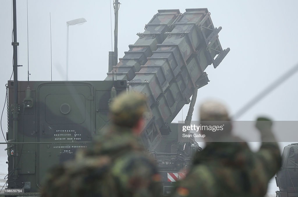 Members of the German Bundeswehr look at a Patriot missile launching system during a press day at the Luftwaffe Warbelow training center on December 18, 2012 in Warbelow, Germany. Germany, along with the USA and the Netherlands, will send two Patriot systems to Turkey in January to protect Turkey from Syrian attacks.