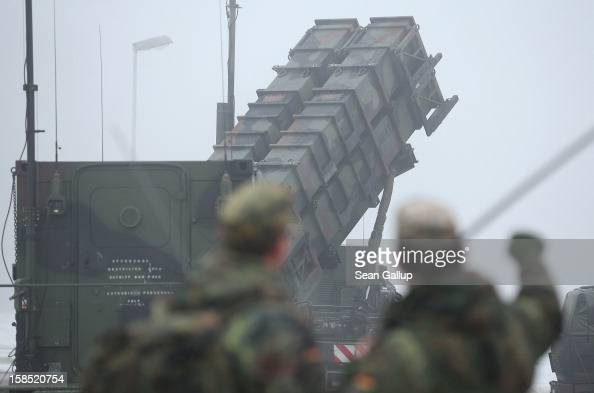 Members of the German Bundeswehr look at a Patriot missile launching system during a press day at the Luftwaffe Warbelow training center on December...