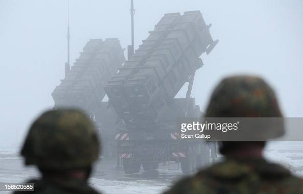 Members of the German Bundeswehr look on as two Patriot missile launching systems stand ready during a press day presentation at the Luftwaffe...
