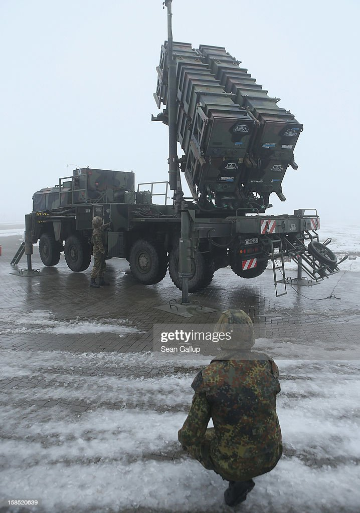 Members of the German Bundeswehr prepare a Patriot missile launching system during a press day presentation at the Luftwaffe Warbelow training center on December 18, 2012 in Warbelow, Germany. Germany, along with the USA and the Netherlands, will send two Patriot systems to Turkey in January to protect Turkey from Syrian attacks.