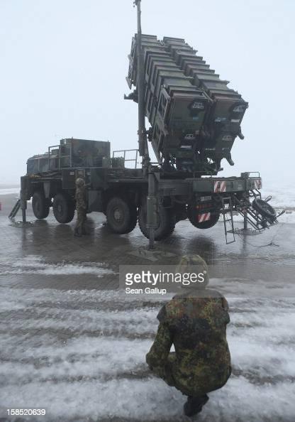 Members of the German Bundeswehr prepare a Patriot missile launching system during a press day presentation at the Luftwaffe Warbelow training center...