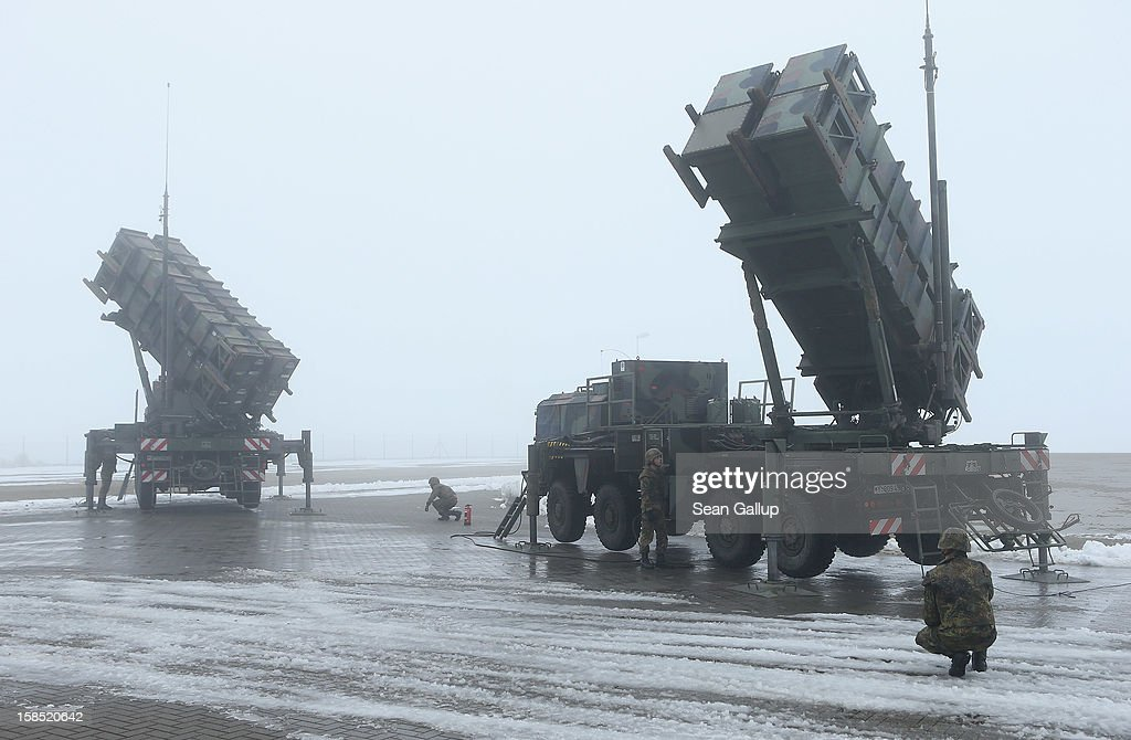 Members of the German Bundeswehr prepare two Patriot missile launching systems during a press day presentation at the Luftwaffe Warbelow training center on December 18, 2012 in Warbelow, Germany. Germany, along with the USA and the Netherlands, will send two Patriot systems to Turkey in January to protect Turkey from Syrian attacks.