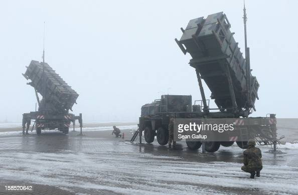 Members of the German Bundeswehr prepare two Patriot missile launching systems during a press day presentation at the Luftwaffe Warbelow training...