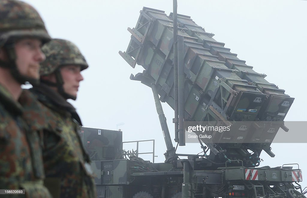 Members of the German Bundeswehr stand at attention next to Patriot missile launching system during a press day presentation at the Luftwaffe Warbelow training center on December 18, 2012 in Warbelow, Germany. Germany, along with the USA and the Netherlands, will send two Patriot systems to Turkey in January to protect Turkey from Syrian attacks.